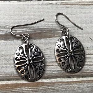 Oval antique silver folk art style pierced earring